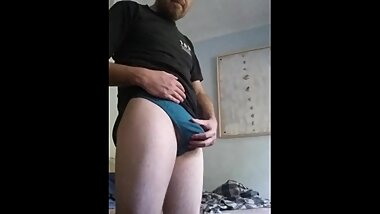 Pulling down my briefs to show off my freshly shaved little winky and balls.