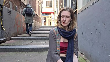 Nervous girl plays with her pussy in the centre of Amsterdam as people walk by